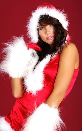 Portrait of beautiful sexy girl wearing santa claus clothes on red background Stock Photo - 5613014