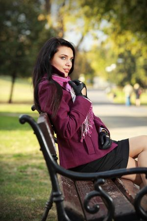 flapping: Beautiful romantic brunette in autumn park