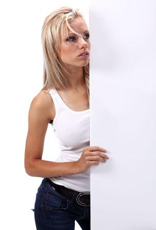 Beautiful blonde girl showing empty white board Stock Photo - 5612975