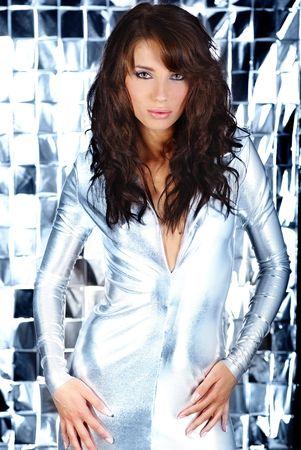 Glamour woman wearing silver dress  photo