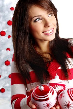 Young Woman decorating white christmas tree Stock Photo - 5812756