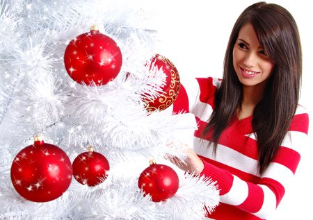 Young Woman decorating white christmas tree Stock Photo - 5812732