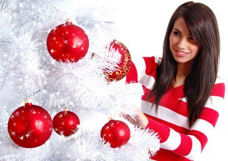 decorating christmas tree: Young Woman decorating white christmas tree Stock Photo
