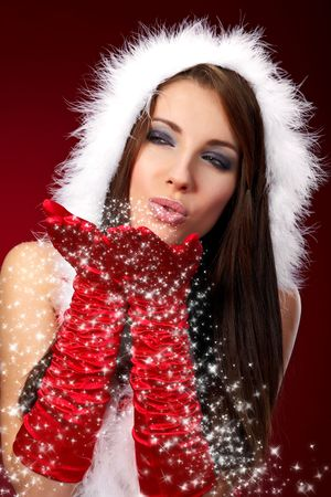 Portrait of beautiful sexy girl wearing santa claus clothes on red background Stock Photo - 5879094