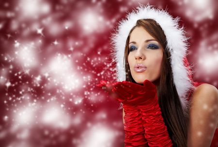 Portrait of beautiful sexy girl wearing santa claus clothes on red background Stock Photo - 5879095