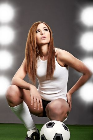 Sexy soccer player, woman on playing field photo