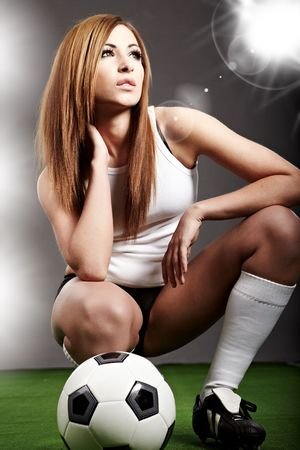 soccer players: Sexy soccer player, woman on playing field Stock Photo
