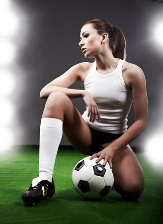 soccer grass: Sexy soccer player, woman on playing field