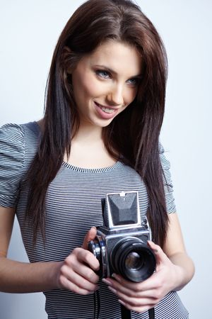 Young beautiful woman with camera photo