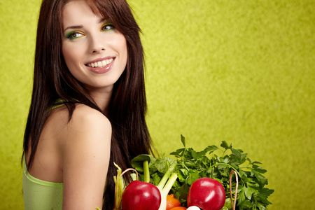 fruit and veg: Portrait of a girl holding in hands full of different fruits and vegetables