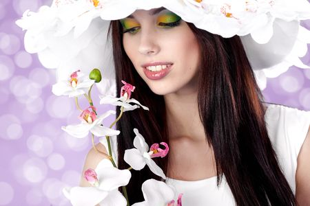Summer woman with orchid Stock Photo - 6633872