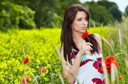 Beautiful  woman in poppy flowers photo