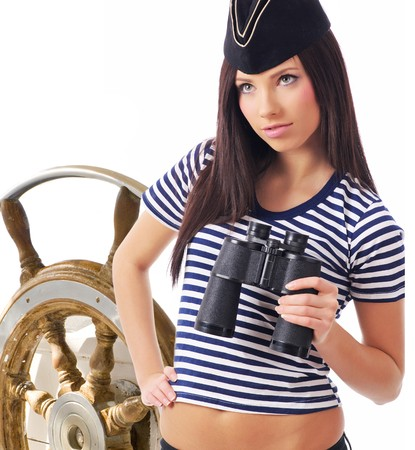 Young captain girl  standing on the yacht is looking through Stock Photo - 6929576