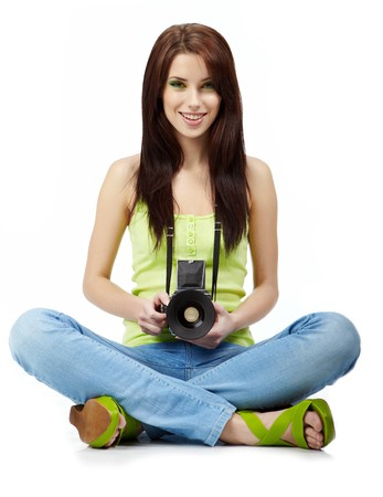 photocamera: Young woman with photo camera. Isolated over white background