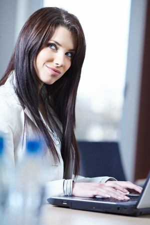 Portrait of happy young business woman in office Stock Photo - 6929689