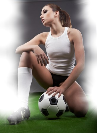 Sexy football player on stadium  photo