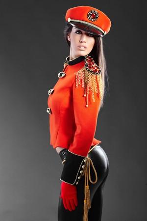 sexy army: Sexy model wearing glamour uniform  Stock Photo