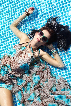 Sexy girl relaxing in a pool  photo