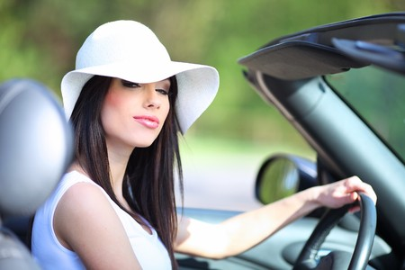 portrait of beautiful summer woman in the cabrio car photo