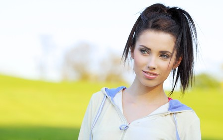 attractive young fitness woman  in the park Stock Photo - 7375504