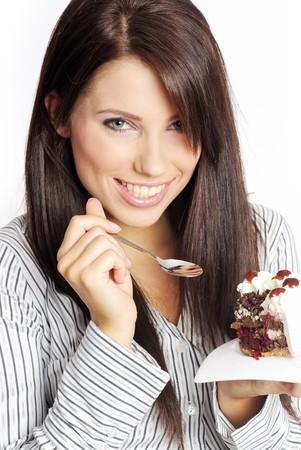 Business woman eating piece of cake. photo