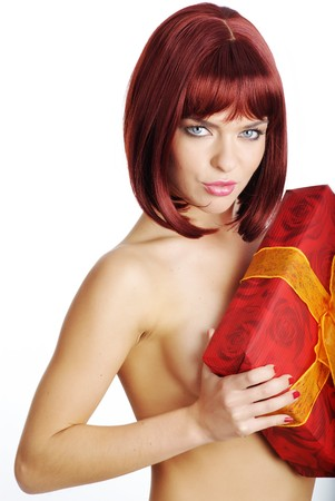 sexy girl smiles and holding a gift in packing photo