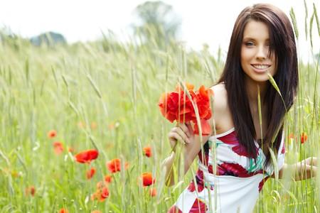 Summer girl running in poppy field
