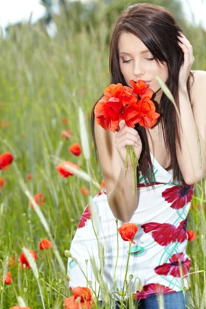 Summer girl running in poppy field Stock Photo - 7392311