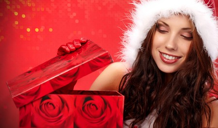 Happy young woman with christmas  gift box Stock Photo - 7436557