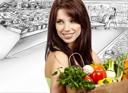 shopper: woman holding a  bag full of healthy food. shopping in mall  Stock Photo