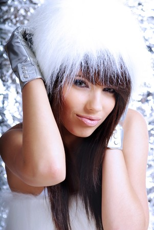 Winter Girl with beautiful make up, silver gloves  photo