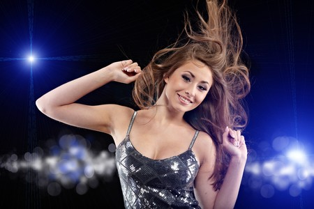 Portrait of a beautiful dancing girl . Black background Stock Photo - 7532689