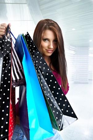 Beautiful shopping woman at a draw mall  photo