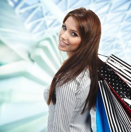 Beautiful shopping woman at a draw mall  Stock Photo - 7762251