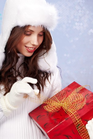 Portrait of a winter woman with gifts. Shot in studio. photo