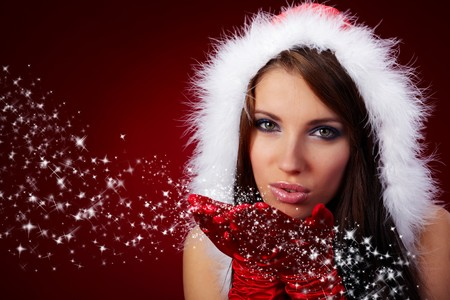 Portrait of beautiful sexy girl wearing santa claus clothes on red background Stock Photo - 7762294