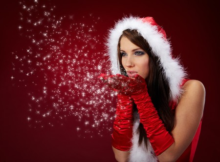 sexy santa: Portrait of beautiful sexy girl wearing santa claus clothes on red background