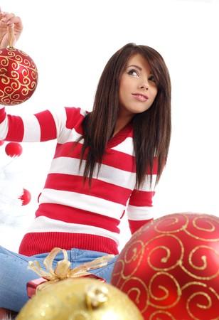 Beautiful girl with gift box next to white christmas tree Stock Photo - 7762348