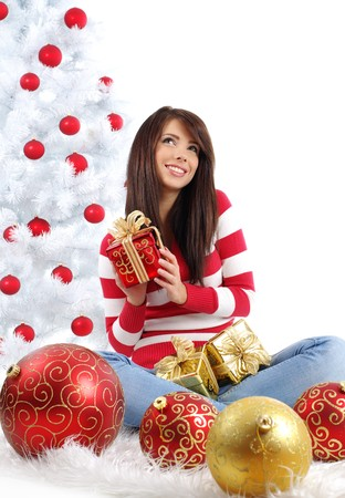 Beautiful girl with gift box next to white christmas tree Stock Photo - 7762359
