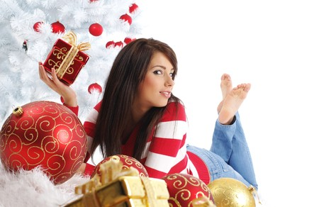 Beautiful girl with gift box next to white christmas tree Stock Photo - 7762334