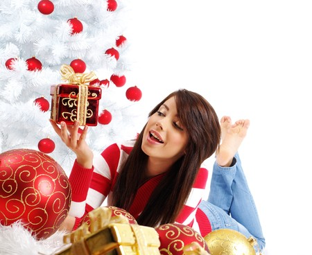 Beautiful girl with gift box next to white christmas tree Stock Photo - 7762322