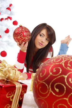 Beautiful girl with gift box next to white christmas tree Stock Photo - 7762337