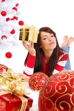Beautiful girl with gift box next to white christmas tree Stock Photo - 7762339