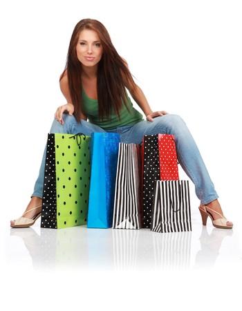 rijke vrouw: vrouw met kleurrijke boodschappentassen in haar hand  Stockfoto
