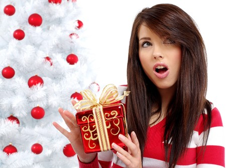 Beautiful woman with gift  next to white christmas tree Stock Photo - 7762356
