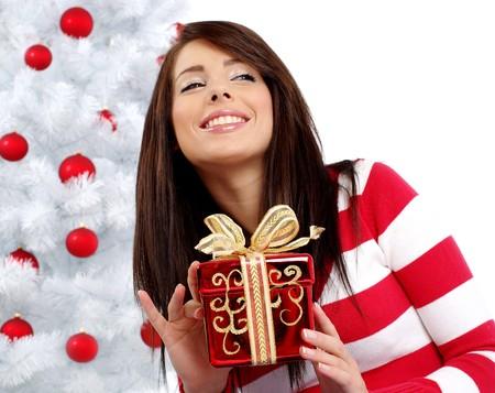 Beautiful woman with gift  next to white christmas tree Stock Photo - 7762338