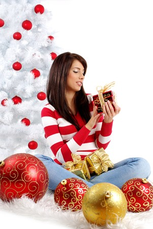 Beautiful woman with gift  next to white christmas tree Stock Photo - 7762370