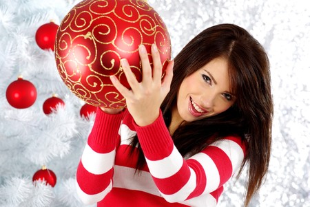 Beautiful woman with gift  next to white christmas tree Stock Photo - 7762364