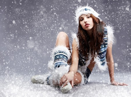 Winter wild woman on snow and grey background Stock Photo - 7762476
