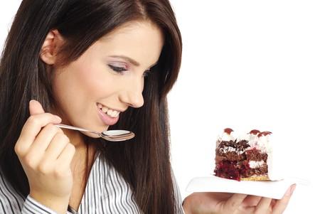 Woman eating cake photo